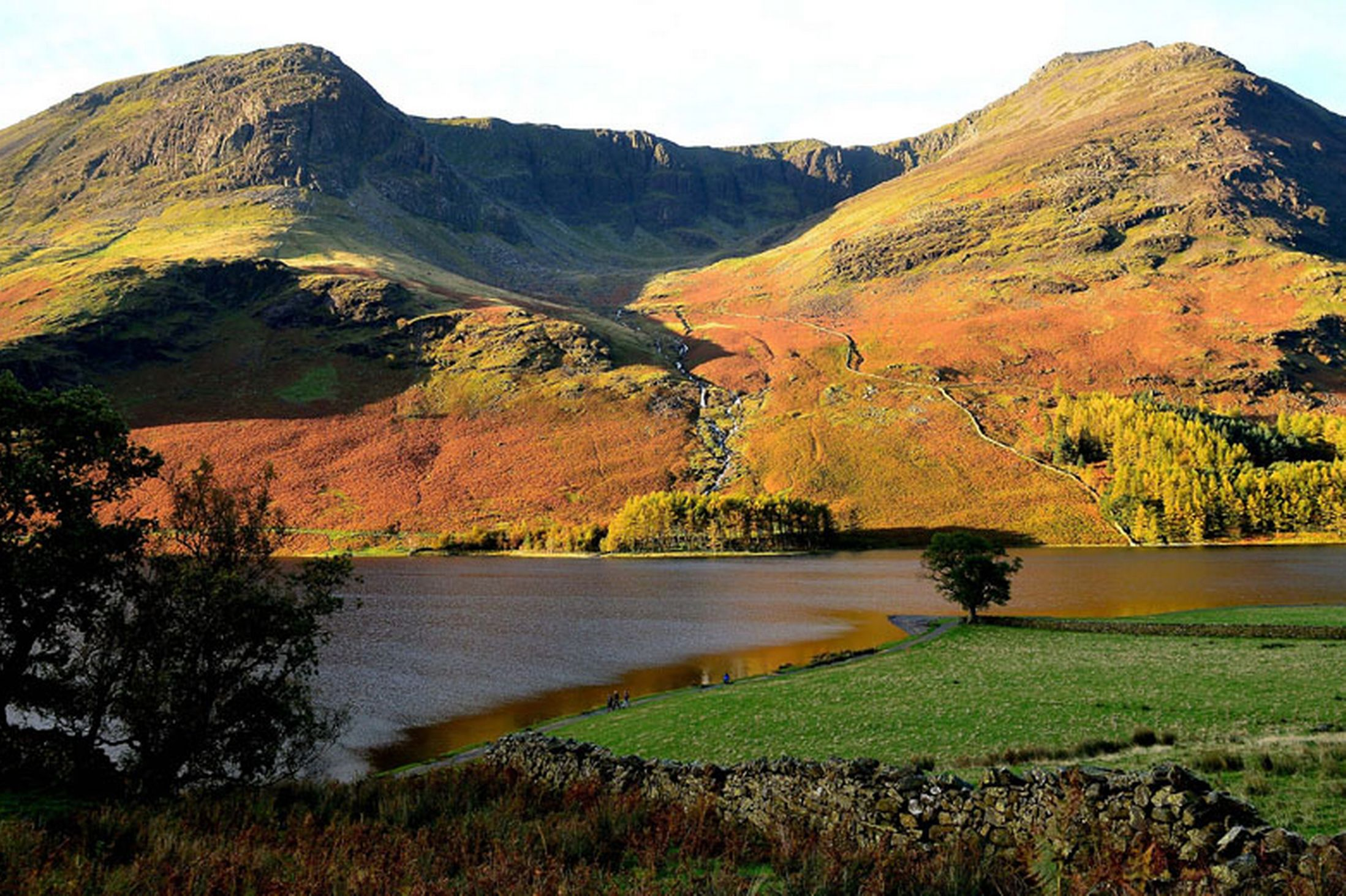 The-sun-picks-out-the-Autumn-colours-on-the-peaks-near-Buttermere-lake-in-Cumbria-24th-October-2641170