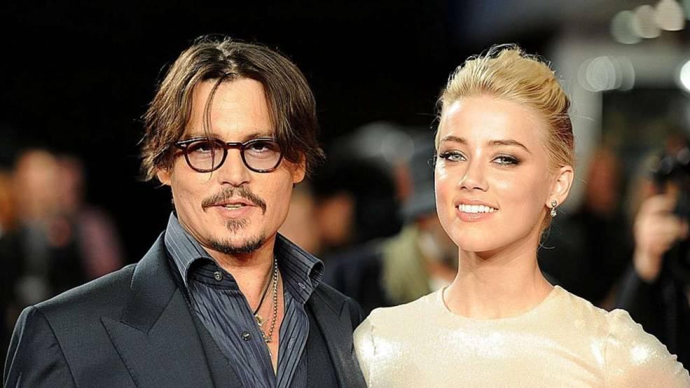 Johnny Depp ve kendisinden 23 yaş küçük yeni sevgilisi Amber Hard...