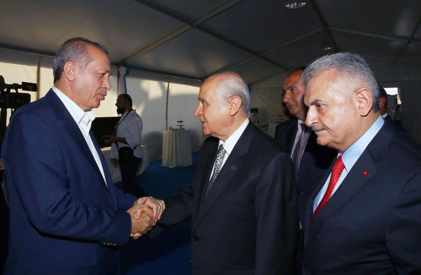 "This handout picture taken and released by the Turkey's Presidential Press Service on August 7, 2016 at Yenikapi district of Istanbul shows Turkish President Recep Tayyip Erdogan (L) shaking hands with the Nationalist Movement Party (MHP) leader Devlet Bahceli (2L) as Turkish Prime Minister Binali Yildirim (R) stands before attending a rally held to protest against the July 15 failed coup. Hundreds of thousands of people gathered in Istanbul today for a pro-democracy rally organised by the ruling party, bringing to an end three weeks of demonstrations in support of President Recep Tayyip Erdogan after last month's failed coup. / AFP PHOTO / TURKISH PRESIDENTIAL PRESS OFFICE / STR / RESTRICTED TO EDITORIAL USE - MANDATORY CREDIT ""AFP PHOTO / TURKEY'S PRESIDENTIAL PRESS SERVICE "" - NO MARKETING - NO ADVERTISING CAMPAIGNS - DISTRIBUTED AS A SERVICE TO CLIENTS"